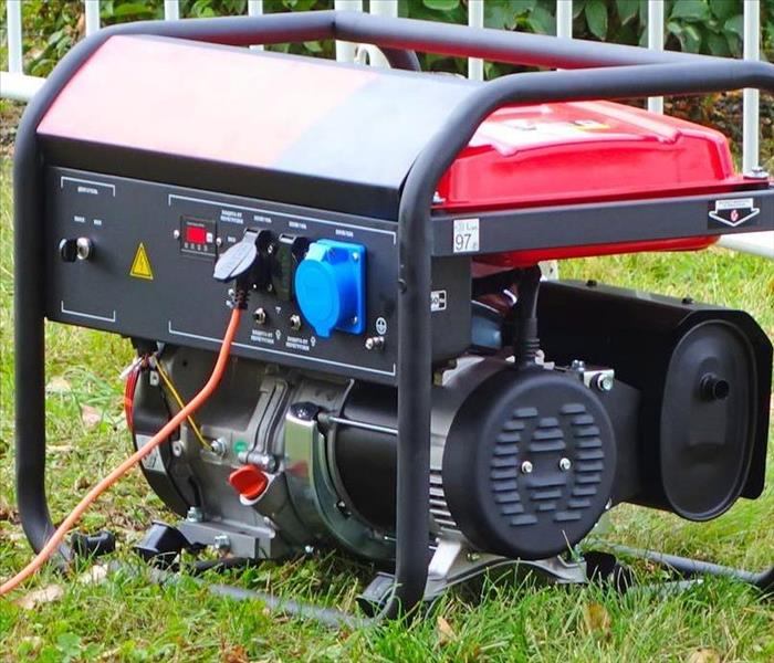 Generator outside of a home a safe distance away from home